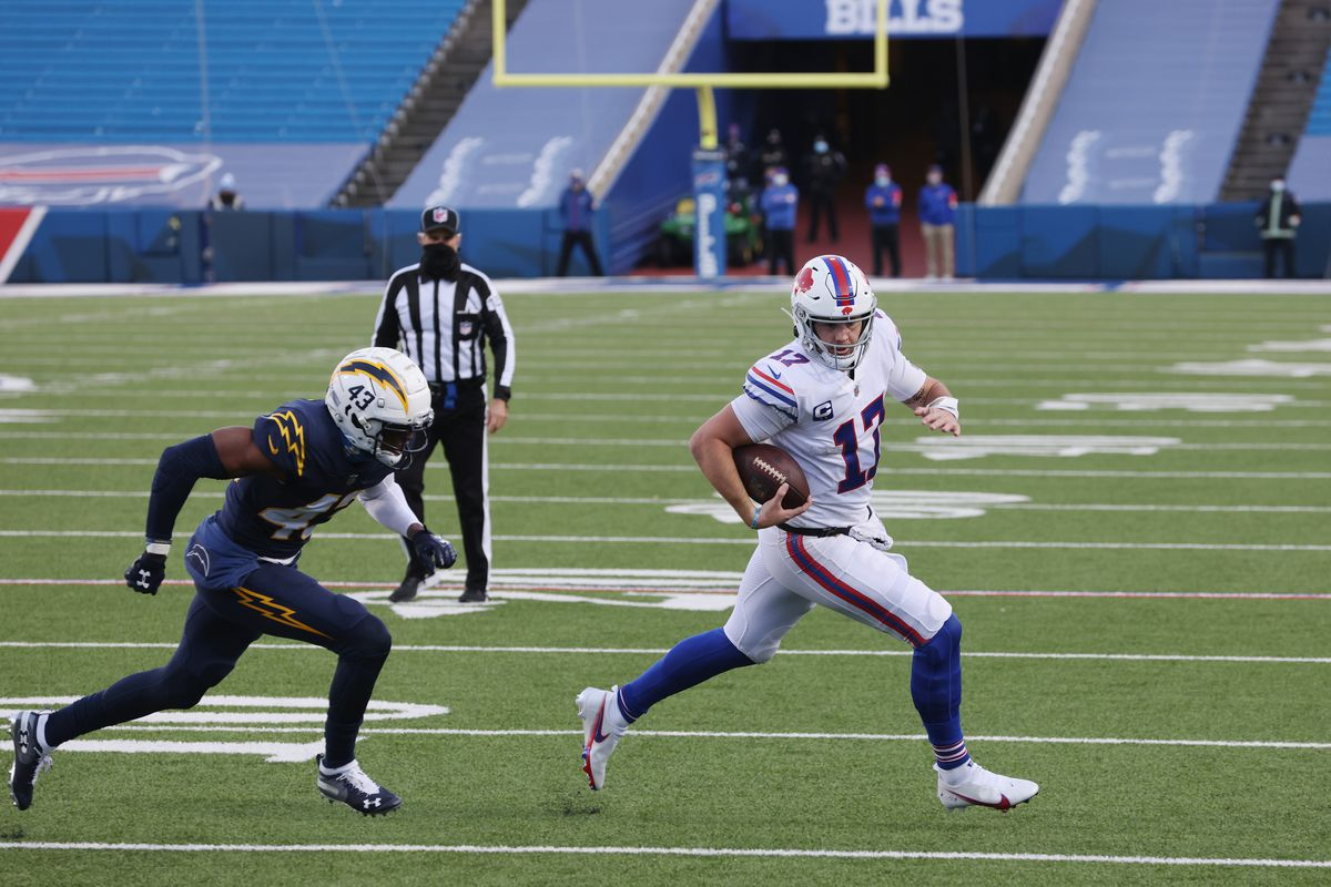 Josh Allen #17 of the Buffalo Bills rolls out against Michael Davis #43 of the Los Angeles Chargers during the third quarter at Bills Stadium on November 29, 2020 in Orchard Park, New York.
