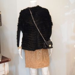 Next, Lawson adds 525 America's Knitted Rabbit Fur Poncho ($425), which works overtime adding both texture and a little warmth to the ensemble.