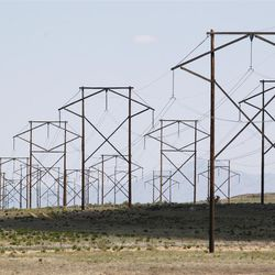 This May 20, 2012, photo shows a major transmission line near Albuquerque, N.M. A lack of transmission prevents the conversion of solar potential into usable watts.