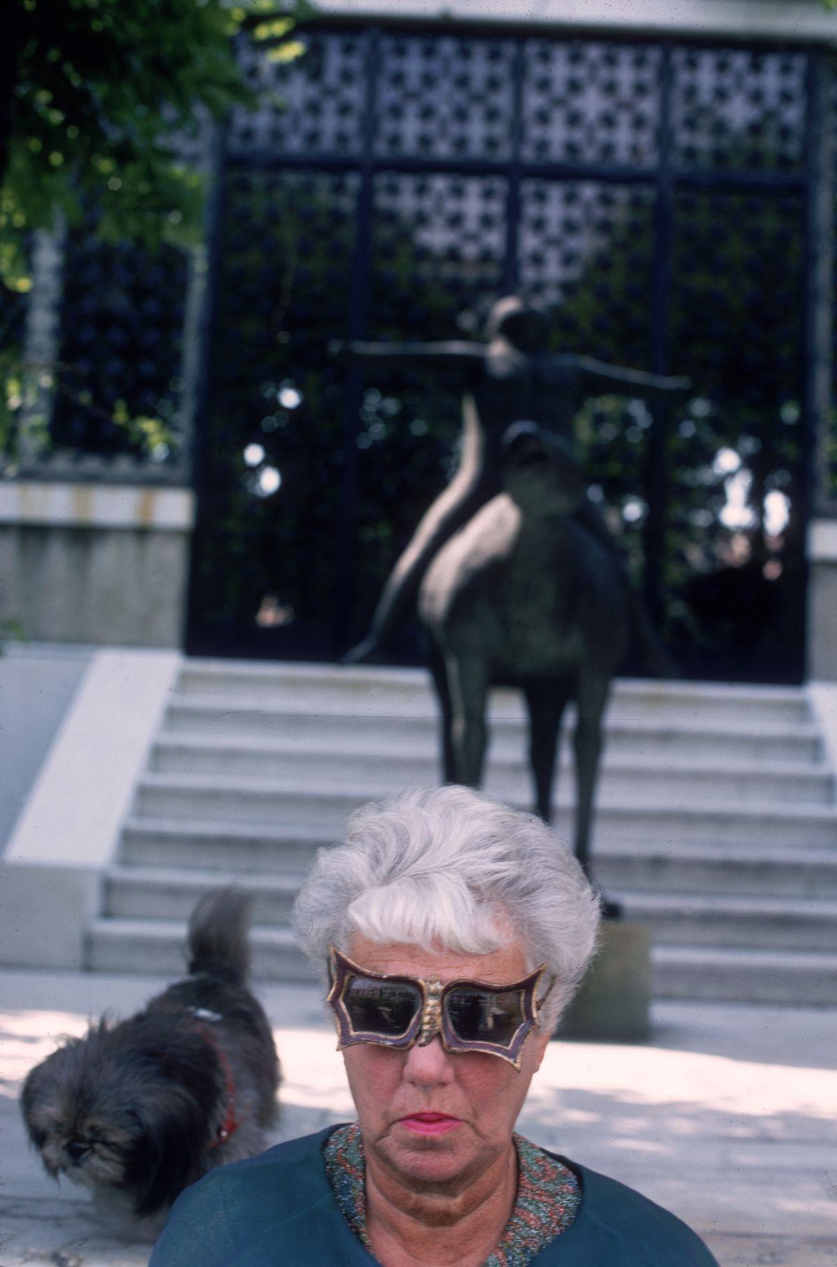"Peggy Guggenheim wears her signature ""bat wing"" glasses."