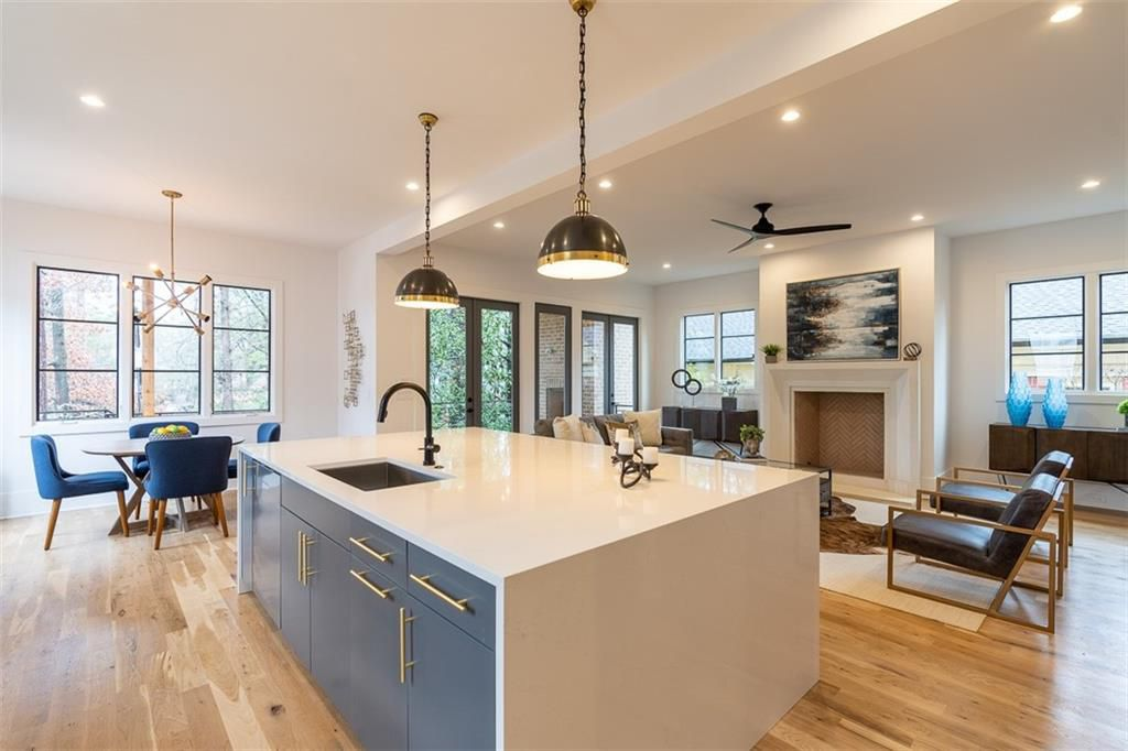 A huge open kitchen area with a living room at right.