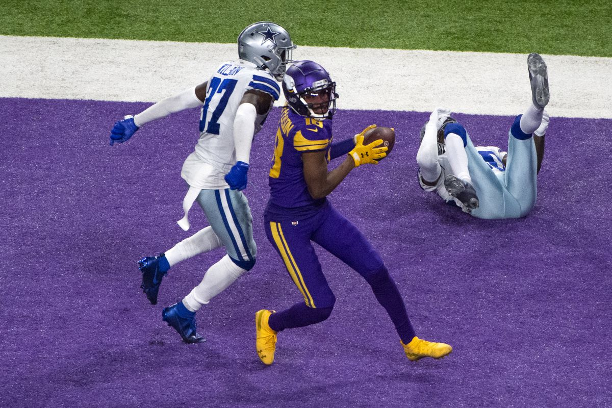 Justin Jefferson #18 of the Minnesota Vikings catches the ball for a touchdown in the fourth quarter of the game against the Dallas Cowboys at U.S. Bank Stadium on November 22, 2020 in Minneapolis, Minnesota.