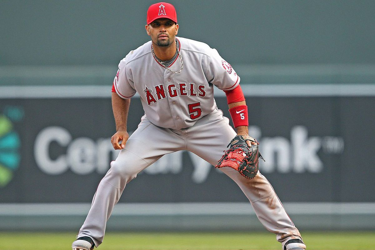 Apr 9, 2012; Minneapolis, MN, USA: Los Angeles Angels first baseman Albert Pujols (5) gets ready to field a ball in the fifth inning against the Minnesota Twins at Target Field. Mandatory Credit: Jesse Johnson-US PRESSWIRE