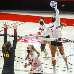 Utah's Dani Drews spikes the ball during a volleyball match against the Southern California Trojans at the Jon M. Huntsman Center at the University of Utah in Salt Lake City on Sunday, Feb. 14, 2021.