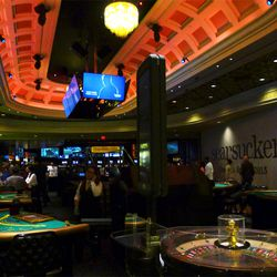 Tired of waiting in line? Omnia has its own gaming area with chair touting the club's name.