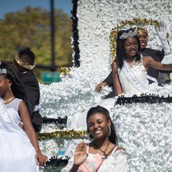 Bud Billiken Princess Abe Mallory, Prince Destin Barnes, Queen Kennedi Eggleston and King Richard Gallion Jr. wave during the Bud Billiken Parade Saturday.