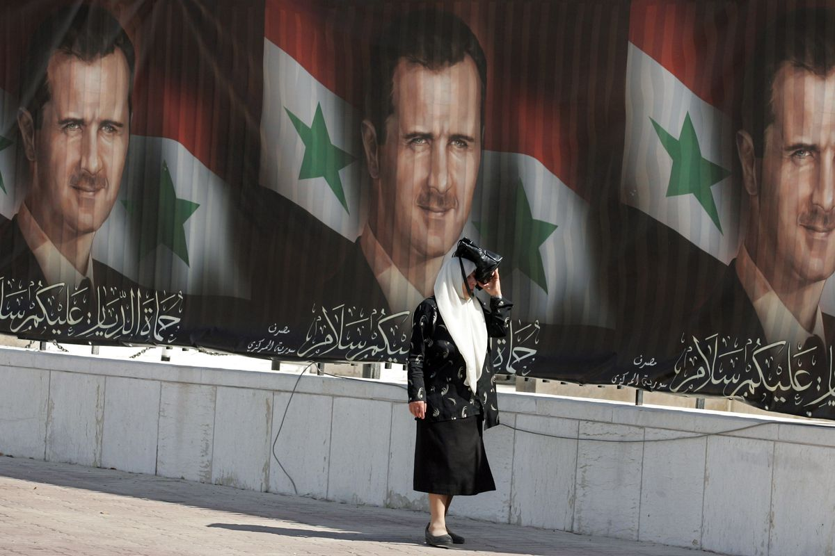 Assad posters in Damascus (HASSAN AMMAR/AFP/Getty)