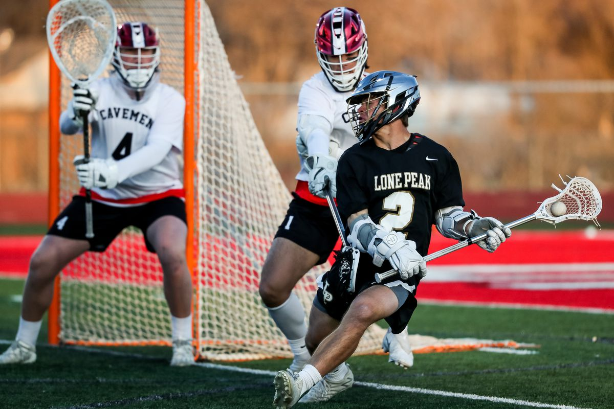 Lone Peak's Garrett Haas tries to get into scoring position in a boys lacrosse game in American Fork on Tuesday, March 30, 2021.