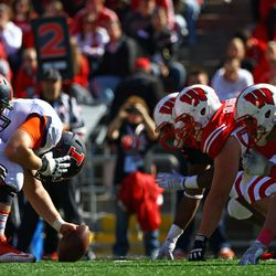 Nose Guard Arthur Goldberg and the Badger defensive line stare down their competition