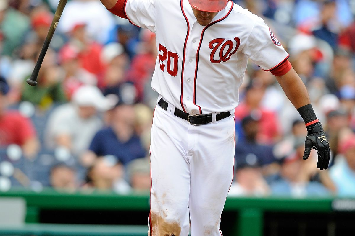 WASHINGTON, DC - JULY 21:  Ian Desmond #20 of the Washington Nationals reacts after striking out during a game against the Atlanta Braves at Nationals Park on July 21, 2012 in Washington, DC.  (Photo by Patrick McDermott/Getty Images)