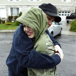 Alyssa Abbott hugs her son David before he gets on the school bus in Spanish Fork, Wednesday, May 18, 2011.