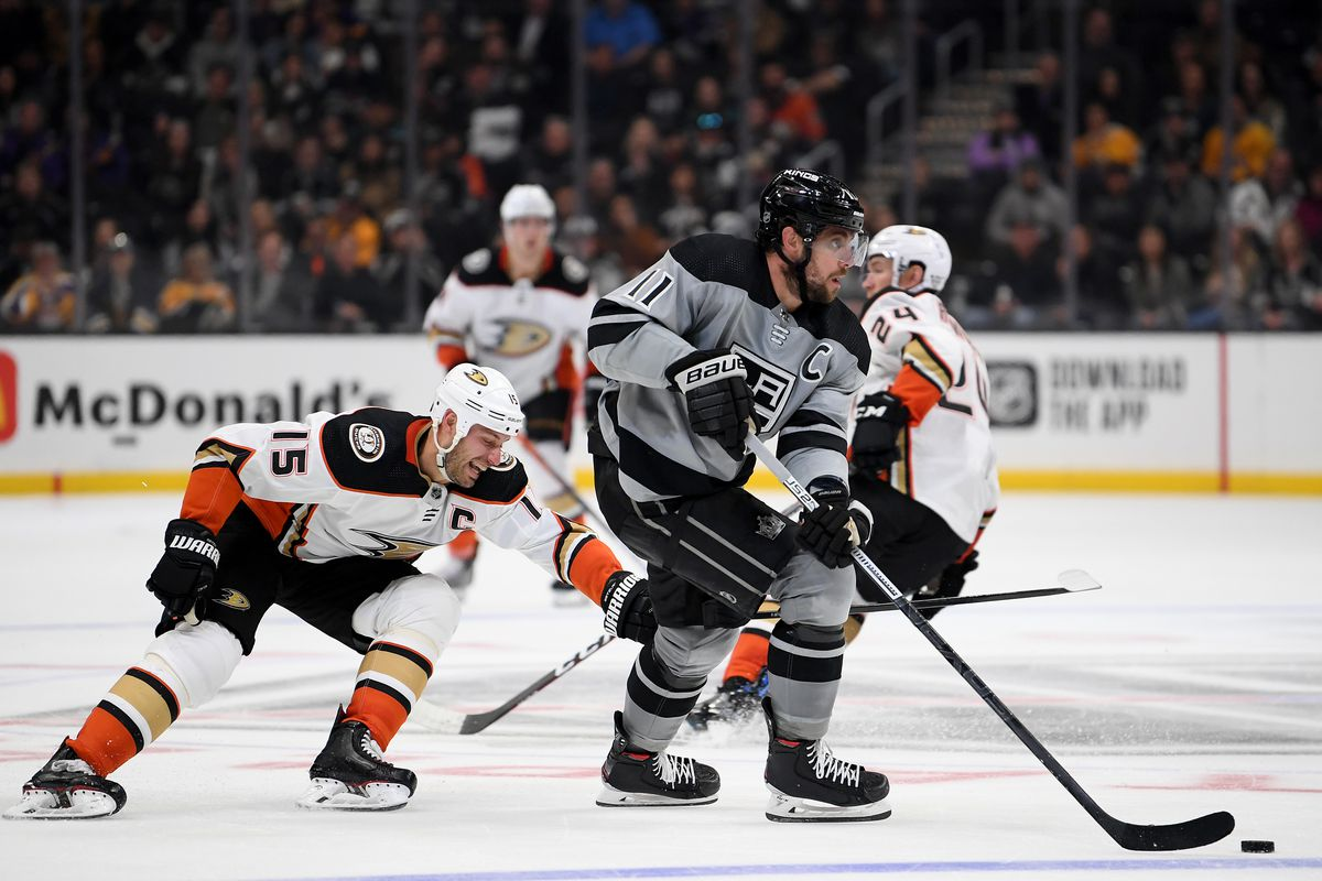 Anze Kopitar #11 of the Los Angeles Kings skates with the puck as he is chased by Ryan Getzlaf #15 of the Anaheim Ducks during the third period in a 3-1 Ducks win at Staples Center on February 01, 2020 in Los Angeles, California.