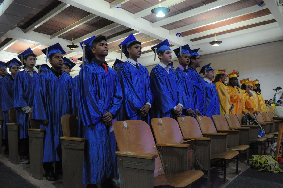 """Eighth graders line up to """"Pomp and Circumstance"""" for M.S. 88's graduation on Wednesday. (Photo by Annie Ma)"""