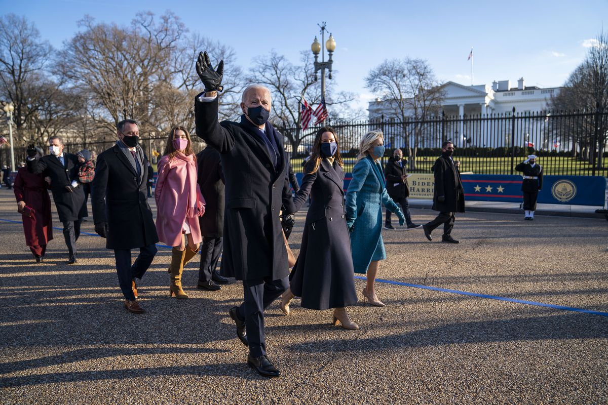 President Joe Biden, First Lady Jill Biden and family, walk in front of the White House during a Presidential Escort to the White House, Wednesday, Jan. 20, 2021 in Washington.