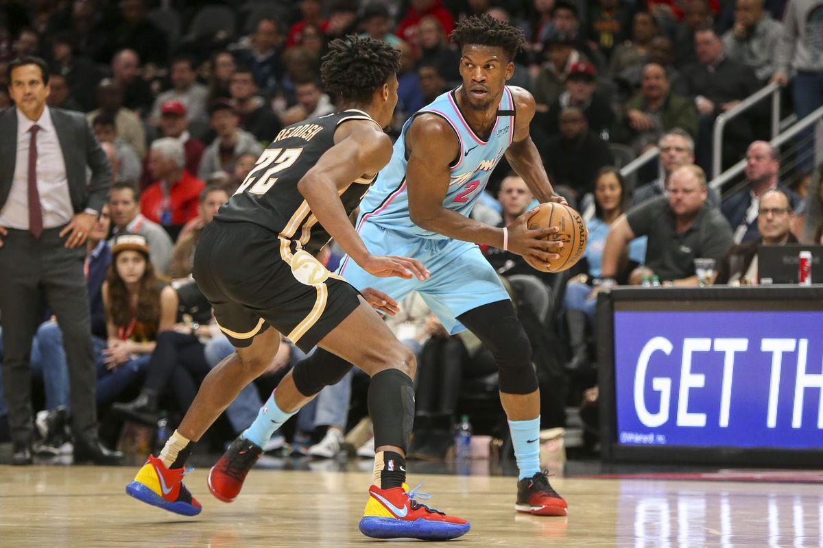 Miami Heat forward Jimmy Butler is defended by Atlanta Hawks guard Cam Reddish in the second quarter at State Farm Arena.