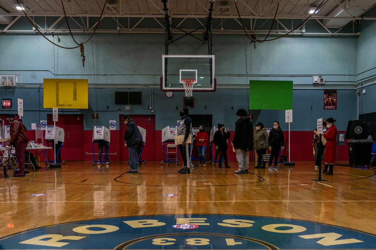 Voters wait in line at P.S. 168 in The Bronx on Election Day, Nov. 3, 2020.