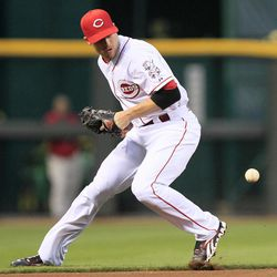 Cincinnati Reds shortstop Zack Cozart knocks down a ground ball hit by Los Angeles Dodgers' Hanley Ramirez in the second inning of a baseball game, Friday, Sept. 21, 2012, in Cincinnati. Ramirez was given a hit on the play.