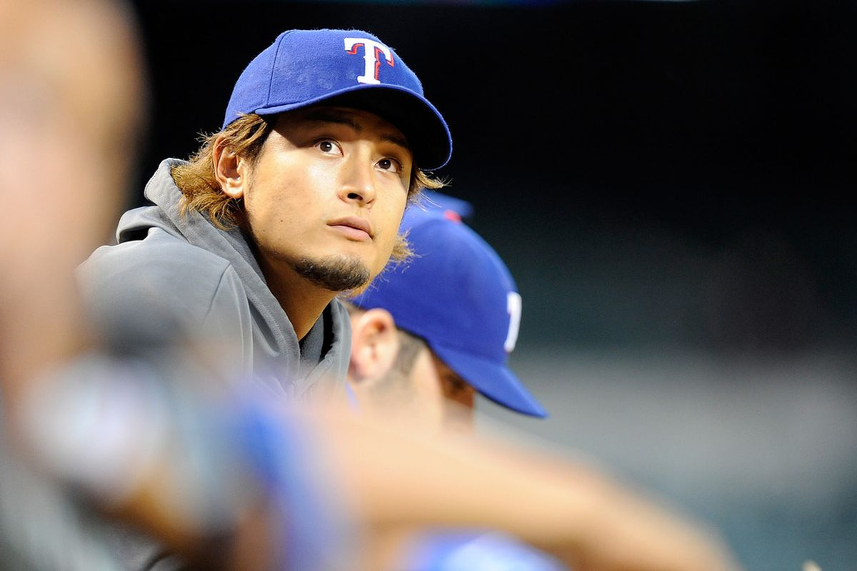BALTIMORE, MD - MAY 07:  Yu Darvish #11 of the Texas Rangers watches the game against the Baltimore Orioles at Oriole Park at Camden Yards on May 7, 2012 in Baltimore, Maryland.  (Photo by Greg Fiume/Getty Images)