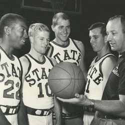 Former Utah State coach Ladell Andersen, right, with players LeRoy Walker, Myron Long, Wayne Estes and Mikey Dittebrand.