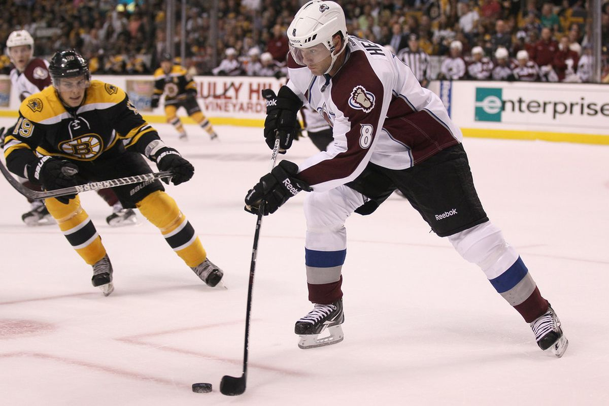 BOSTON, MA - OCTOBER 10:  Jan Hejda #8 of the Colorado Avalanche clears the puck as Tyler Seguin #19 of the Boston Bruins defends on October 10, 2011 at TD Garden in Boston, Massachusetts.  (Photo by Elsa/Getty Images)
