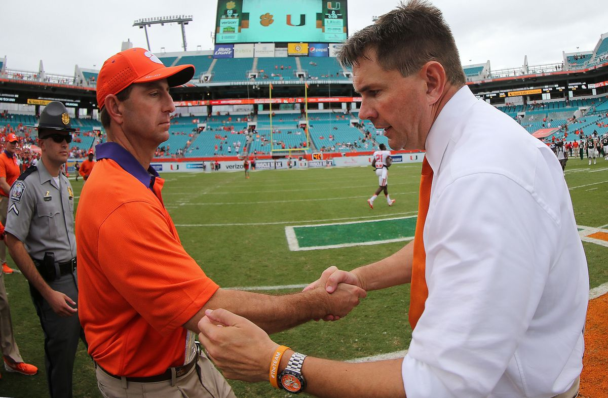 MIAMI GARDENS, FL - OCTOBER 24:  Head coach Al Golden of the Miami Hurricanes  and head coach Dabo Swinney of the Clemson Tigers  shake hands after a game  at Sun Life Stadium on October 24, 2015 in Miami Gardens, Florida.  (Photo by Mike Ehrmann/Getty Images)