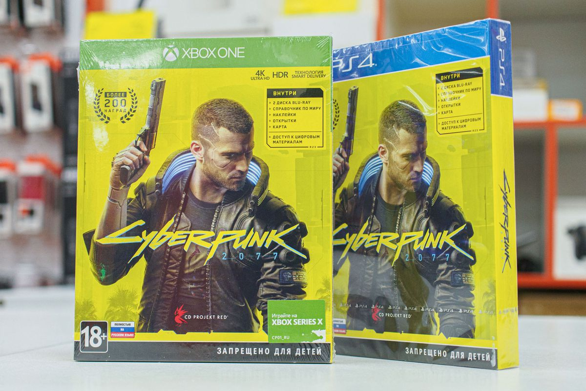 Cyberpunk game discs for PlayStation and XBox consoles. The...