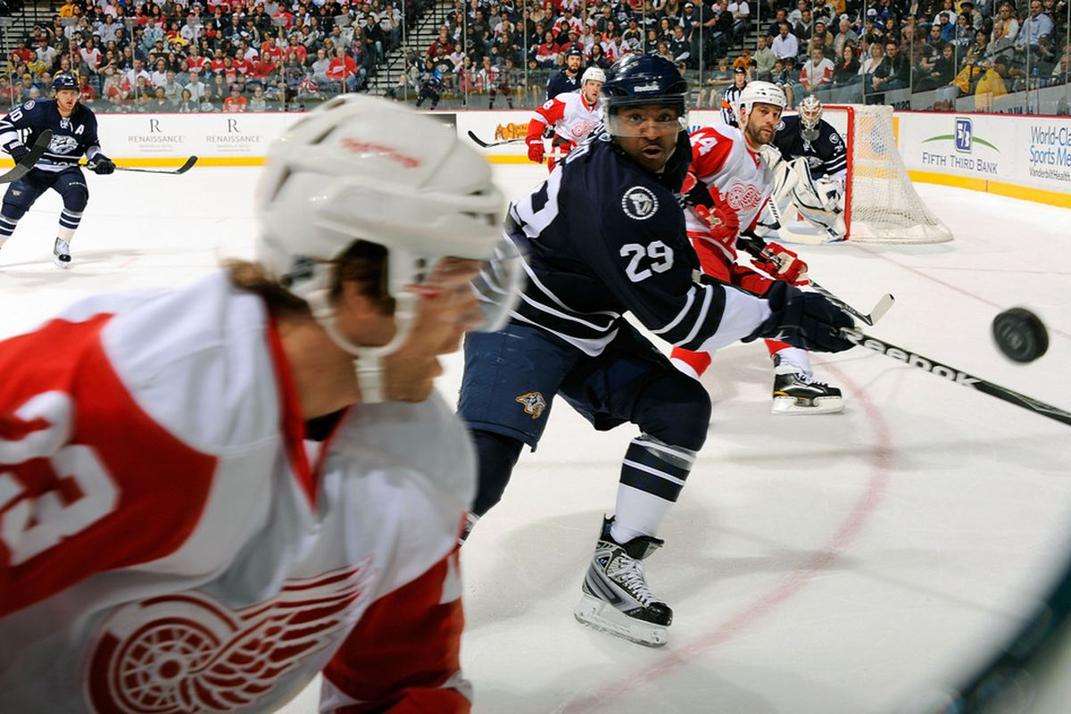 NASHVILLE, TN - APRIL 02:  Joel Ward #29 of the Nashville Predators watches the puck pass Brad Stuart #23 of the Detroit Red Wings on April 2, 2011 at the Bridgestone Arena in Nashville, Tennessee.  (Photo by Frederick Breedon/Getty Images)