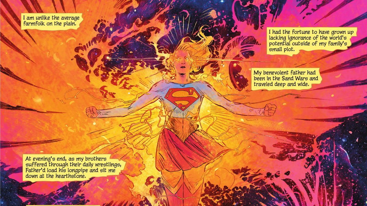 Supergirl floats in space, arms flexed, wreathed in magenta, orange, and yellow flames in the shape of phoenix wings, fire glowing from her eyes like stars in Supergirl: Woman of Tomorrow #2 (2021).