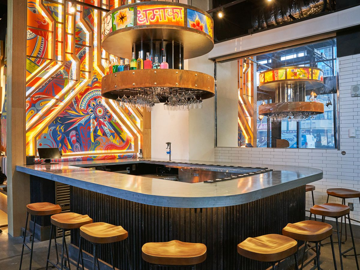 The interior of the restaurant Dhamaka with an oval shaped bar