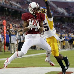 Stanford wide receiver Drew Terrell (4) grabs an 11-yard touchdown next to San Jose State cornerback Ronnie Yell (25) during the first half of an NCAA college football game in Stanford, Calif., Friday, Aug.  31, 2012.