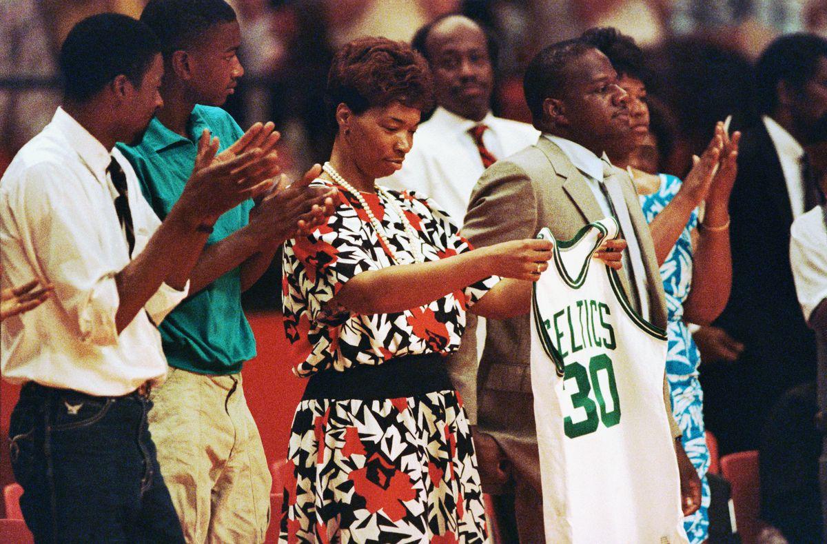 Lonise Bias Holding Celtics Jersey