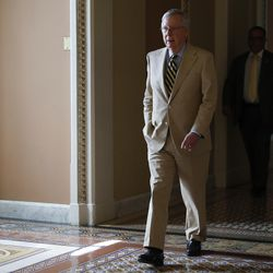 Senate Majority Leader Mitch McConnell of Ky., walks to his office from the Senate floor on Capitol Hill in Washington, Monday, June 26, 2017. Senate leaders scrambled Tuesday to rescue their health care bill, in deepening jeopardy as opposition from rebellious Republicans intensified. The defections loomed as Congress' nonpartisan budget referee said the measure would leave 22 million more people uninsured by 2026 than President Barack Obama's law.