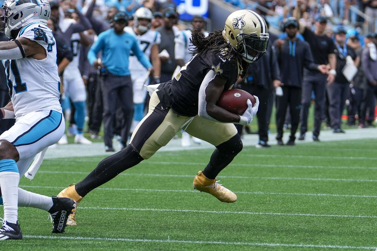 New Orleans Saints running back Alvin Kamara (41) runs the ball against the Carolina Panthers during the second half at Bank of America Stadium.