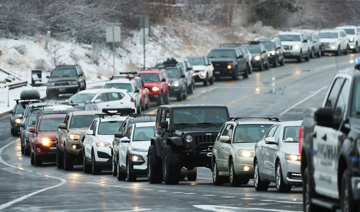 Skier traffic is backed up on Wasatch Boulevard at the mouth of Big Cottonwood Canyon in Salt Lake City on Sunday, Jan. 24, 2021.