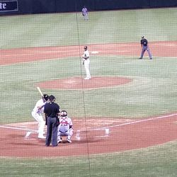 Miguel Romero pitches in the fifth inning