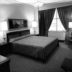 King-sized beds filled only part of large rooms at Hotel Utah. Most rooms had either king beds or two double beds. June 2, 1967.