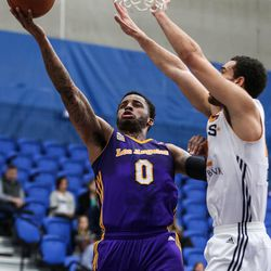 Los Angeles D-Fenders guard Vander Blue (0) lays it up ahead of Salt Lake City Stars forward JJ O'Brien (22) at the Lifetime Activities Center in Taylorsville on Wednesday, Feb. 08, 2017.