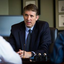 Utah Valley University President Matthew S. Holland works in his office with staff members Kyle Reyes, special assistant to the president for inclusion, and Kathryn Zabriskie, assistant to the chief of staff and board of trustees, in his office on the UVU campus in Orem on Wednesday March 15, 2017.