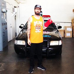 Founder and CEO Joshy D. (He injured his left arm while riding the skateboard ramp he built inside the warehouse.)