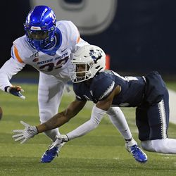 Boise State safety JL Skinner, left, breaks up a pass intended for Utah State wide receiver Deven Thompkins during the first half of an NCAA college football game Saturday, Nov. 23, 2019, in Logan, Utah.