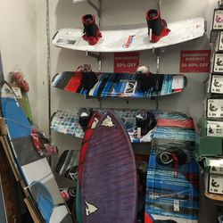 Snowboards, boogie boards, and surfboards, priced as marked