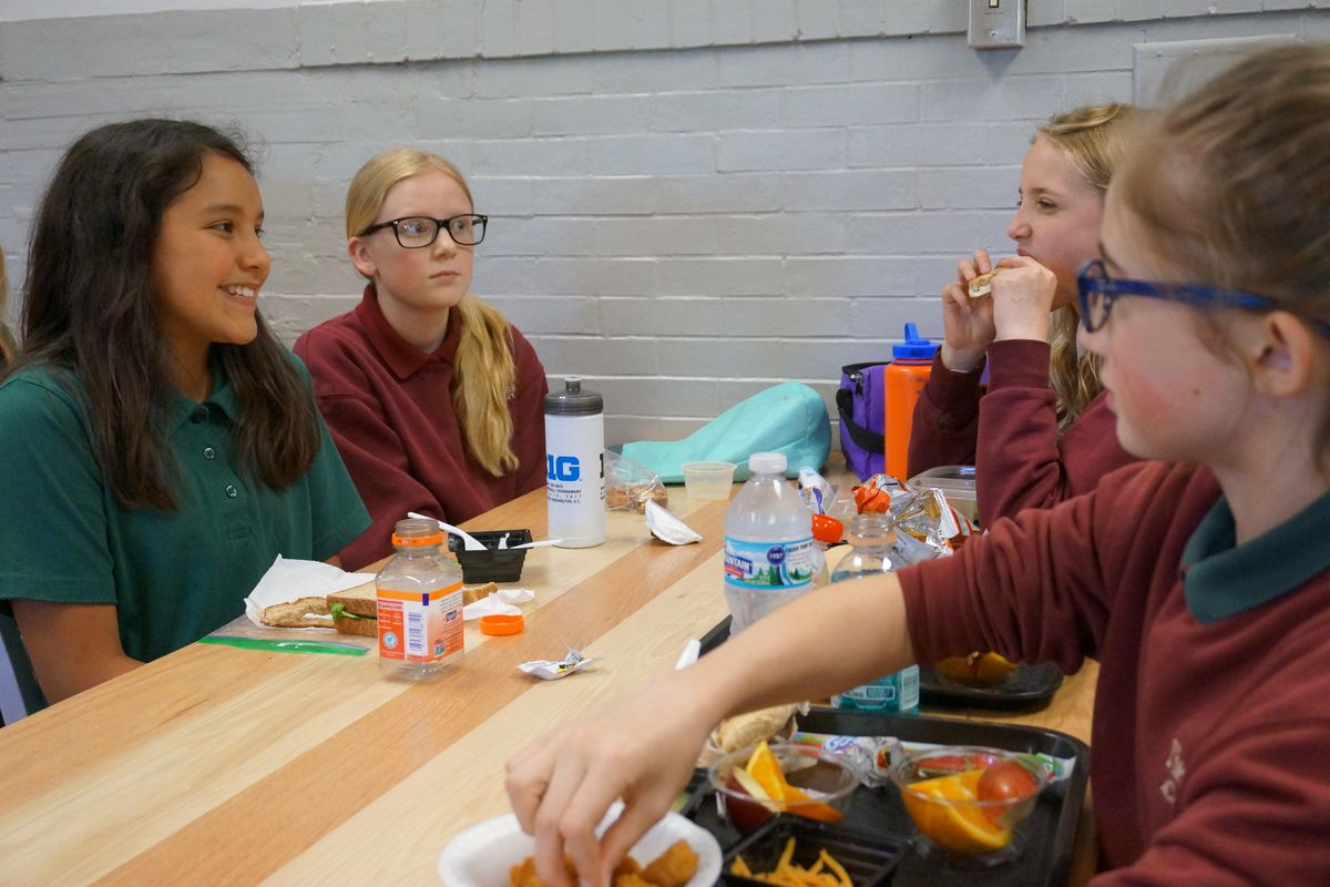 Students eat lunch at the Oaks Academy Middle School, a private Christian school that is integrated by design.