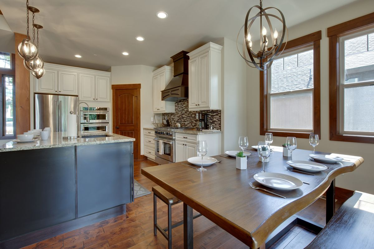 Dining and kitchen areas with a rustic and modern look.