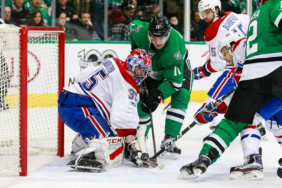 Montreal Canadiens Goalie Al Montoya (35) fights off a puck and Dallas Stars Left Wing Curtis McKenzie (11) during the NHL game between the Montreal Canadiens and Dallas Stars on January 4, 2017, at American Airlines Center in Dallas, TX.