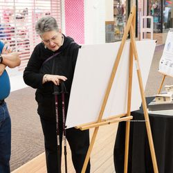 Rev. Connie Campbell-Pearson, right, talks with a shopper at a local mall Monday April 24, 2017. She planned and has begun collecting donations for Housing First Village, a tiny-home development that will include dozens of single-occupant units in Bozeman, Mont.