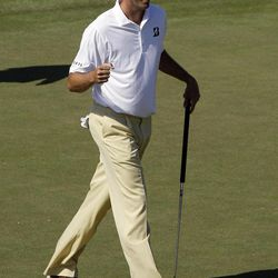 Matt Kuchar reacts after a birdie putt on the ninth hole during the third round of the Masters golf tournament Saturday, April 7, 2012, in Augusta, Ga.