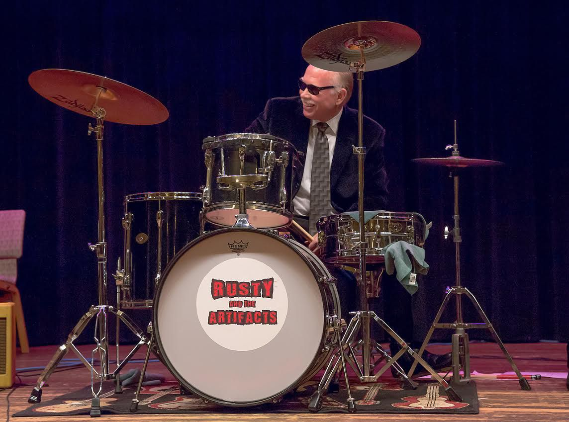 Russell L. Lewis Jr. played with museum colleagues in the band Rusty and the Artifacts. He also played drums for the Frozen Ground Blues Band.   Chicago History Museum