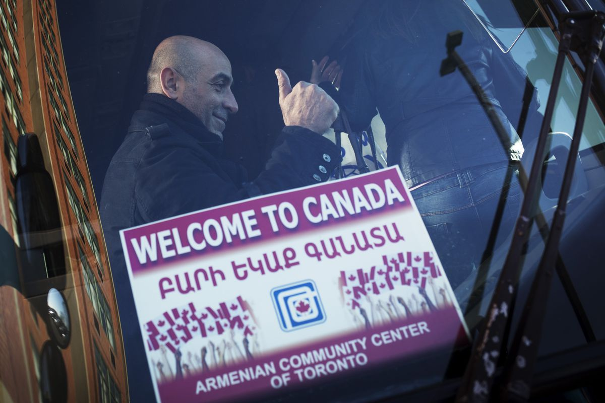 A Syrian refugee arriving in Canada.
