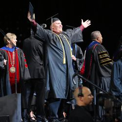 Josh Robinson celebrates after receiving his degree during Salt Lake Community College's commencement ceremony at the Maverik Center in West Valley City on Friday, May 6, 2016.