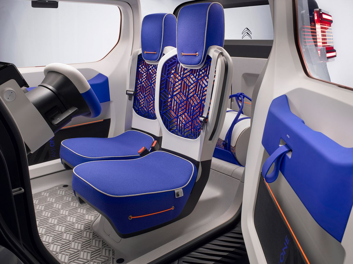 Rendering of inside of car with blue seats